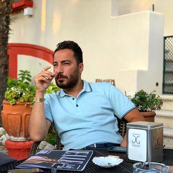 چهره جدی نوید محمدزاده در حال سیگار کشیدن + عکس