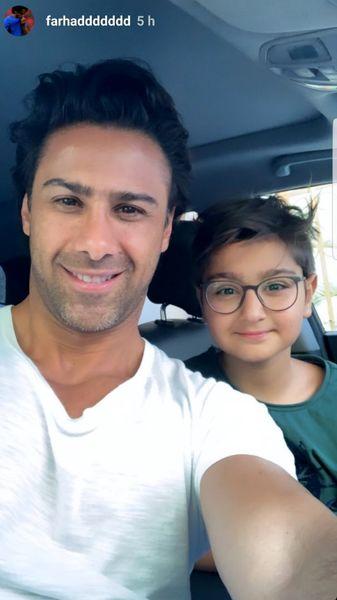 عکس فرهاد مجیدی و پسر بانمکش در ماشین